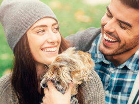 Image of happy couple with dog