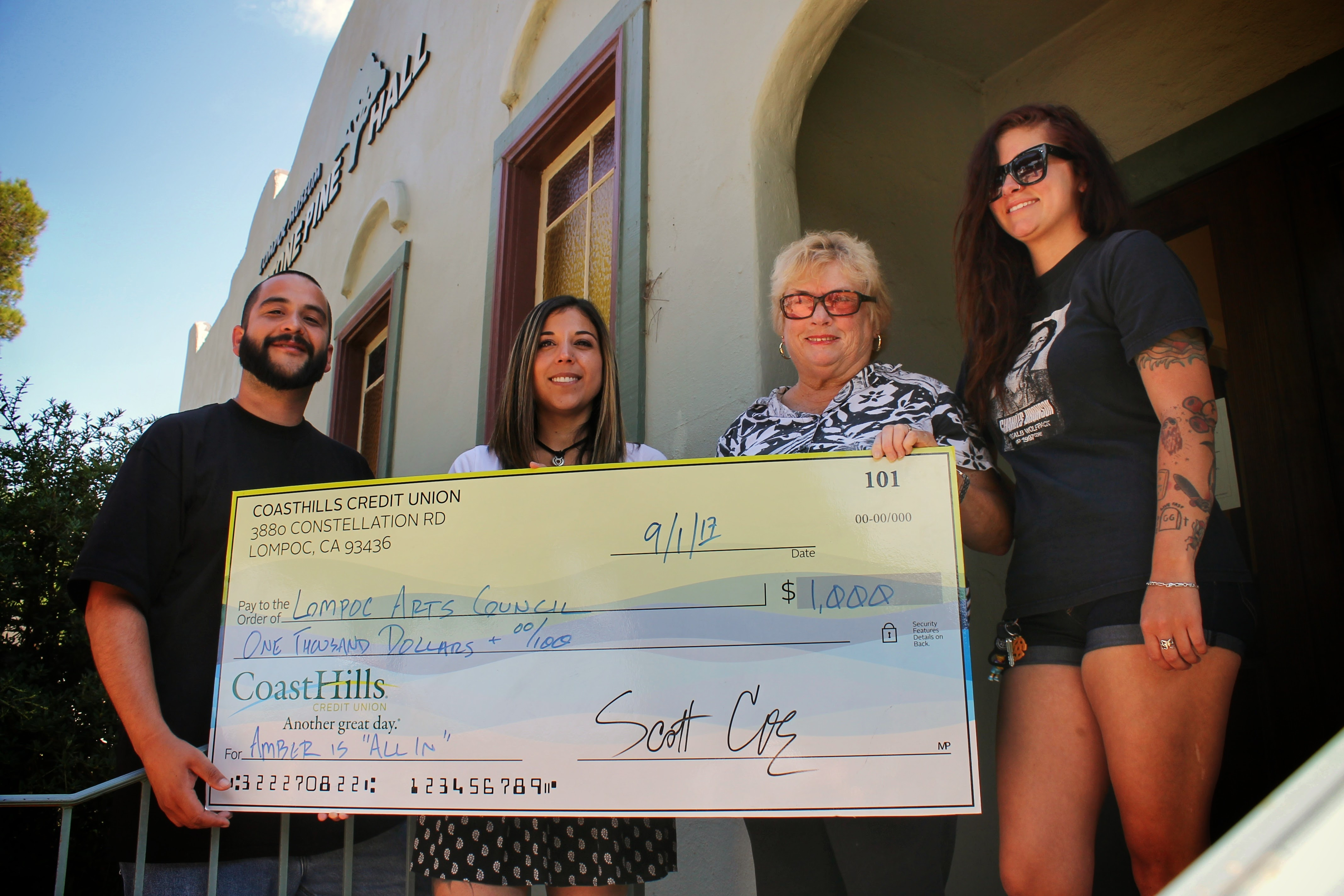 Representatives from CoastHills, First Thursdays and the Lompoc Arts Council pose with a check for $1,000.