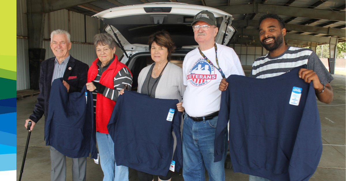 Hugh Rafferty and Sergei Sanders help CoastHills donate 100 hooded sweatshirts to Santa Barbara County Veterans Stand Down 2019.