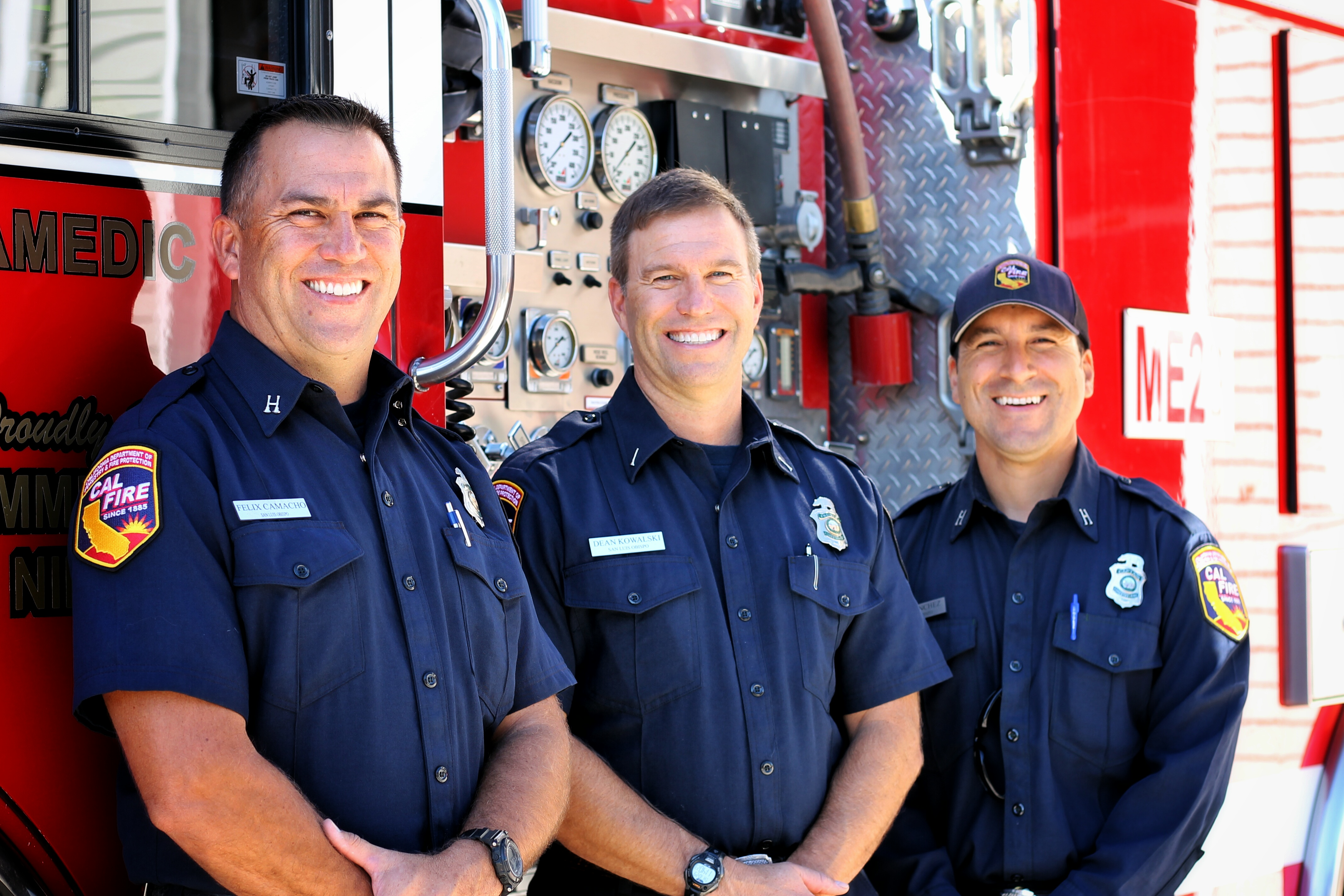 Members of the San Luis Obispo County Fire Department stand near a fire engine at the Nipomo station. CoastHills donated more than $1,300 to the Firefighters Benevolent Fund on International Credit Union Day 2015.